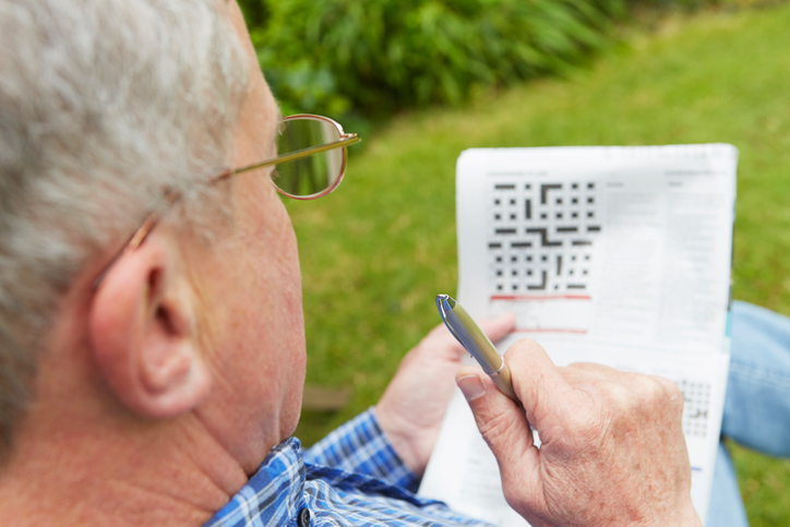 Man doing a crossword puzzle