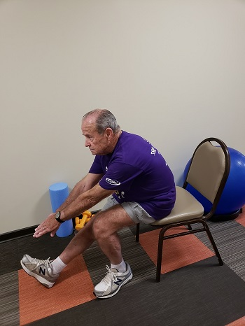 sitting hamstring and lower back stretch senior exercise