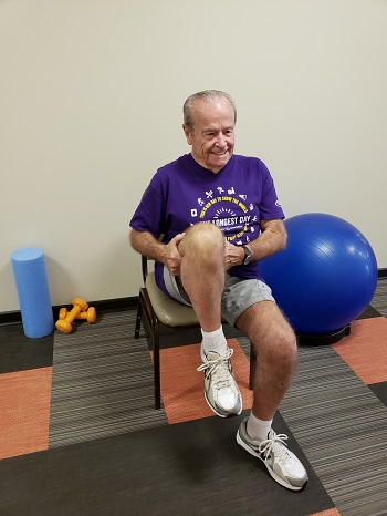 sitting knee to chest stretch senior exercise