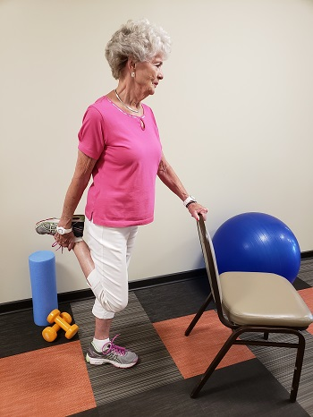 standing quadriceps stetch senior exercise