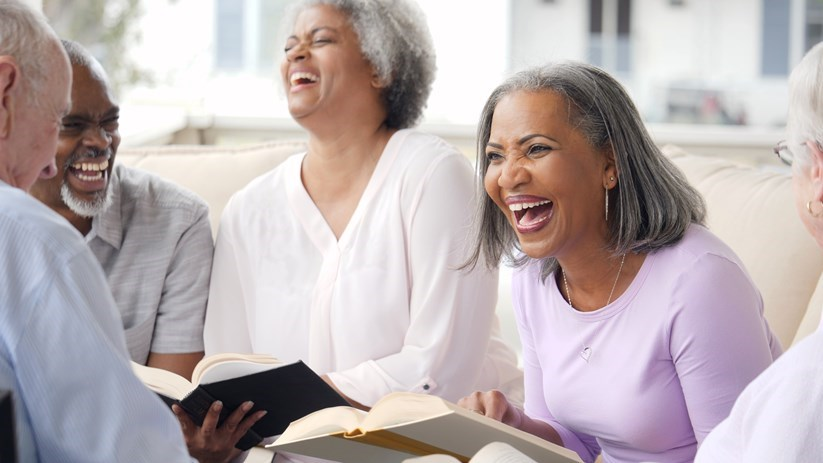 Seniors in bible study laughing together